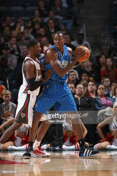 Dwight Howard of the Orlando Magic posts up against Hakim Warrick of the Milwaukee Bucks on November 28 2009 at the Bradley Center in Milwaukee...