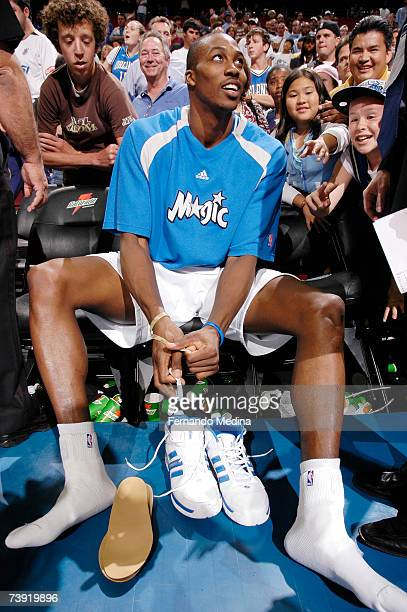 Dwight Howard of the Orlando Magic prepares to give away his game shoes after the final regular season game against the Miami Heat on April 18 2007...