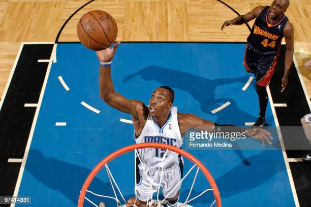 Dwight Howard of the Orlando Magic reaches for a rebound against the Golden State Warriors during the game on March 3 2010 at Amway Arena in Orlando...