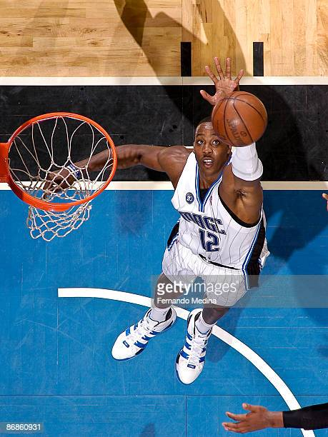 Dwight Howard of the Orlando Magic reaches to block a shot against the Boston Celtics in Game Three of the Eastern Conference Semifinals during the...