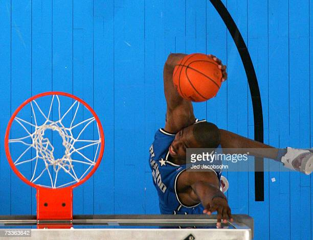 Dwight Howard of the Orlando Magic reaches up to put a sticker on the backboard during a dunk in the Sprite Slam Dunk Competition during NBA All-Star...