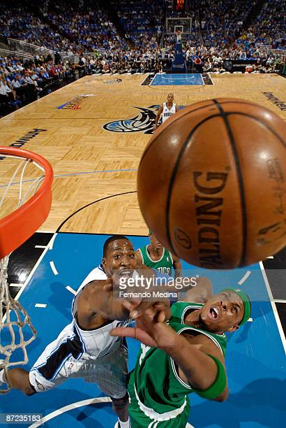Dwight Howard of the Orlando Magic rebounds against Paul Pierce of the Boston Celtics in Game Six of the Eastern Conference Semifinals during the...