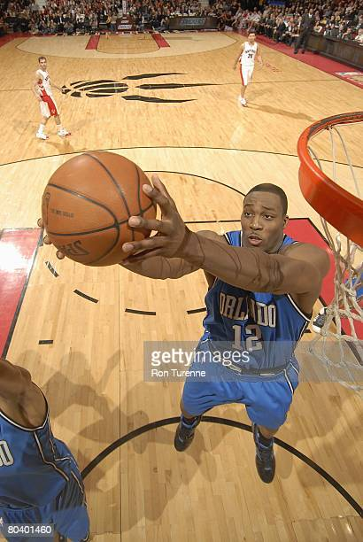 Dwight Howard of the Orlando Magic rebounds against the Toronto Raptors during the game on February 20 2008 at the Air Canada Centre in Toronto...
