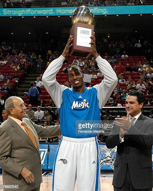 Dwight Howard of the Orlando Magic receives his trophy for winning the 2008 Sprite Slam Dunk Contest before a game against the Philadelphia 76ers at...