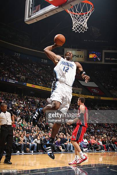Dwight Howard of the Orlando Magic shoots against Brook Lopez of the New Jersey Nets on October 30 2009 at the IZOD Center in East Rutherford New...
