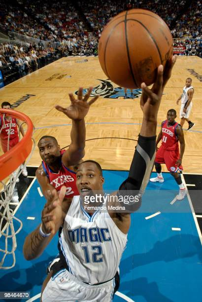 Dwight Howard of the Orlando Magic shoots against Elton Brand of the Philadelphia 76ers during the game on April 14 2010 at Amway Arena in Orlando...