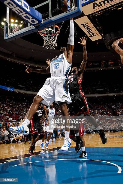 Dwight Howard of the Orlando Magic shoots against Joel Anthony of the Miami Heat during the preseason game on October 7 2008 at Amway Arena in...