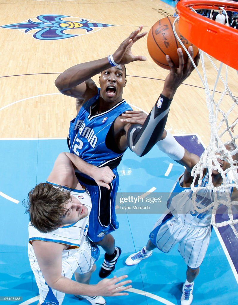 Dwight Howard #12 of the Orlando Magic shoots over Aaron Gray #34 of the New Orleans Hornets on February 26, 2010 at the New Orleans Arena in New Orleans, Louisiana.