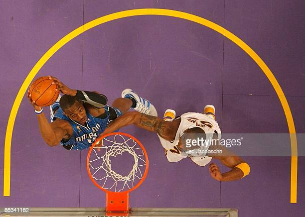 Dwight Howard of the Orlando Magic shoots over Kobe Bryant of the Los Angeles Lakers during Game Two of the 2009 NBA Finals at Staples Center on June...