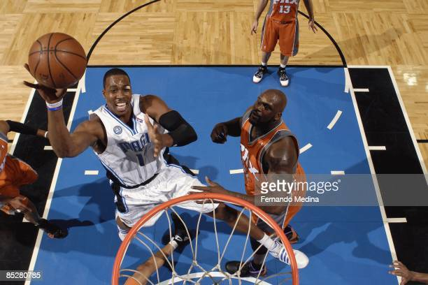 Dwight Howard of the Orlando Magic shoots over Shaquille O'Neal of the Phoenix Suns during the game on March 3 2009 at Amway Arena in Orlando Florida...