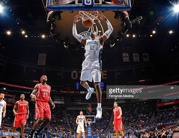 Dwight Howard of the Orlando Magic shoots the basketball against the Houston Rockets on December 26 2011 at Amway Center in Orlando Florida NOTE TO...
