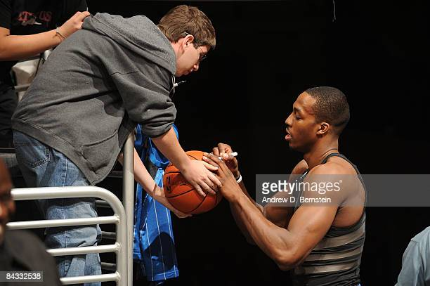 Dwight Howard of the Orlando Magic signs autographs for a fan before a game against the Los Angeles Lakers at Staples Center on January 16 2009 in...