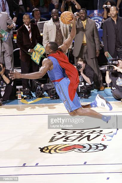 Dwight Howard of the Orlando Magic soars for a dunk during the Sprite Slam Dunk Contest part of AllStar Weekend at the New Orleans Arena February 16...