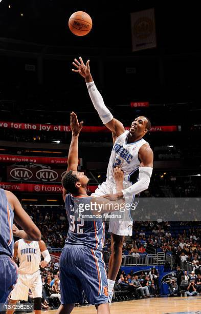 Dwight Howard of the Orlando Magic takes a jump shot over Boris Diaw of the Charlotte Bobcats during the game on January 17 2012 at Amway Center in...