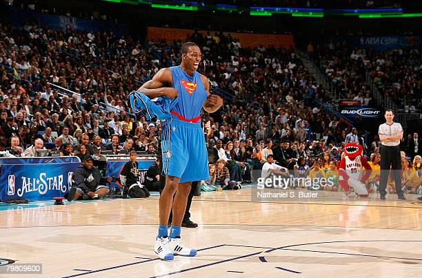 Dwight Howard of the Orlando magic takes off his jersey to prepare for his Superman dunk during the Sprite Slam Dunk Contest part of 2008 NBA AllStar...