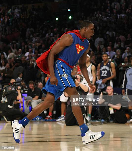 Dwight Howard of the Orlando Magic wearing a Superman Cape in the Sprite SlamDunk Contest reacts at the New Orleans Arena during the 2008 NBA AllStar...