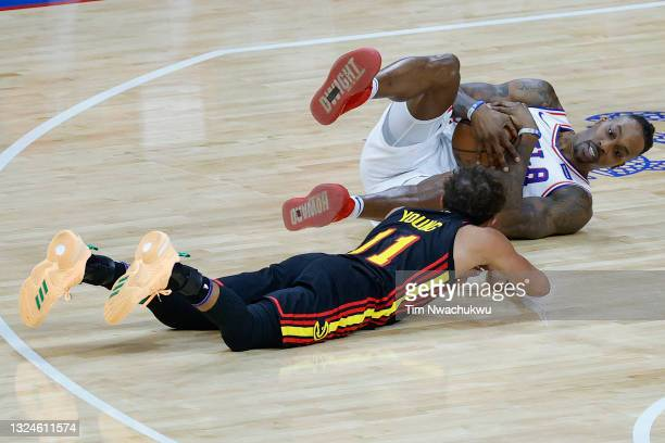 Dwight Howard of the Philadelphia 76ers fouls Trae Young of the Atlanta Hawks during the second quarter during Game Seven of the Eastern Conference...