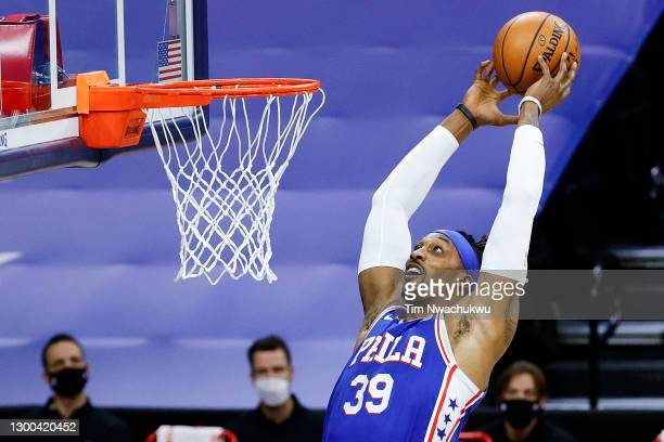 Dwight Howard of the Philadelphia 76ers reaches for a dunk during the first quarter against the Portland Trail Blazers at Wells Fargo Center on...
