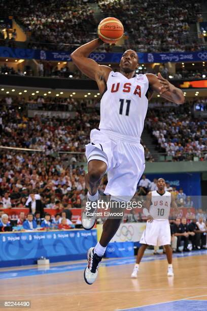 Dwight Howard of the US Men's Senior National Team dunks against China during day 2 of the men's preliminary basketball game at the 2008 Beijing...