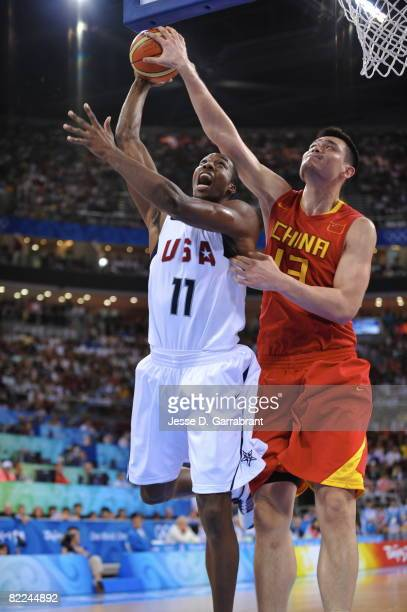 Dwight Howard of the US Men's Senior National Team gets his shot blocked by Yao Ming of China during day 2 of the men's preliminary basketball game...