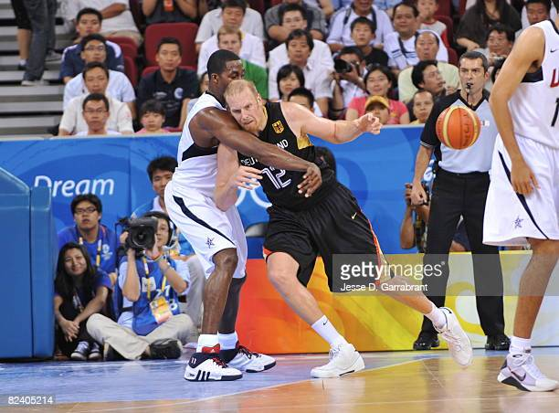 Dwight Howard of the U.S. Men's Senior National Team knocks the ball away from Chris Kaman of Germany during the men's group B basketball...