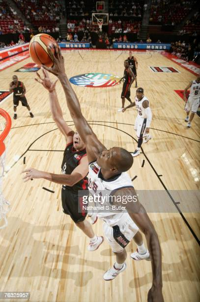 Dwight Howard of the USA Men's Senior National Team blocks a shot against Jesse Young of Canada during the first round of the 2007 FIBA Americas...