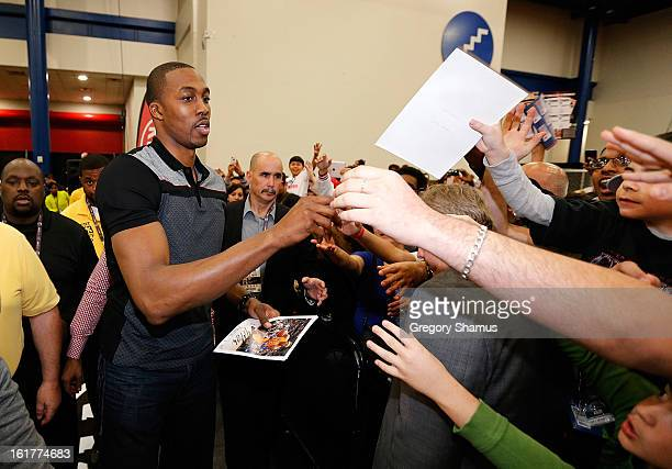 Dwight Howard passes out autographs at the Kia MVP Court during the 2013 NBA Jam Session on February 14 2013 at the George R Brown Convention Center...