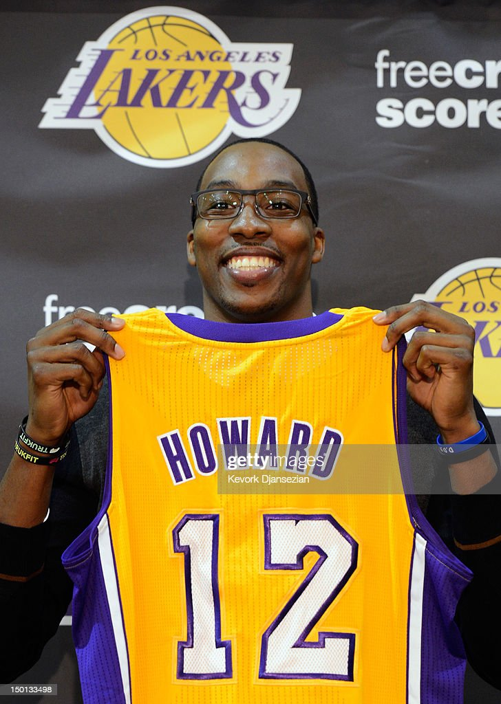 online store 3a5d4 ad9de Dwight Howard poses with his new Los Angeles Lakers jersey ...