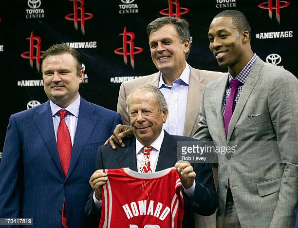 Dwight Howard poses with Houston Rockets owner Les Alexander Houston Rockets general manager Daryl Morey and Houston Rockets head coach Kevin McHale...