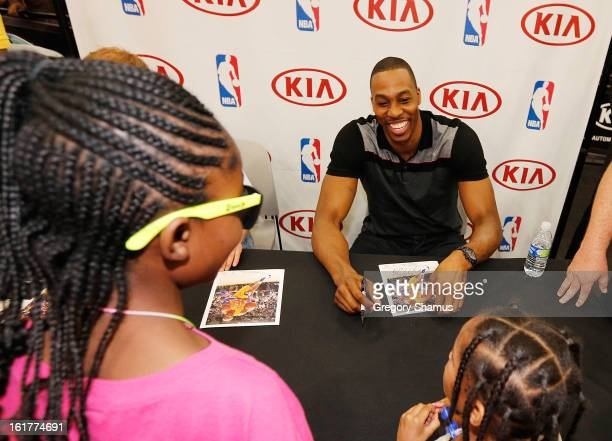 Dwight Howard signs autographs at the Kia MVP Court during the 2013 NBA Jam Session on February 14 2013 at the George R Brown Convention Center in...