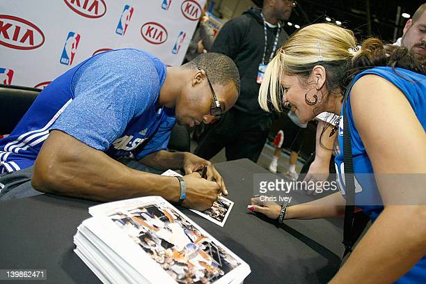 Dwight Howard Signs autographs in the Kia MVP court at Jam Session during NBA All Star Weekend on February 25, 2012 at the Orange County Convention...