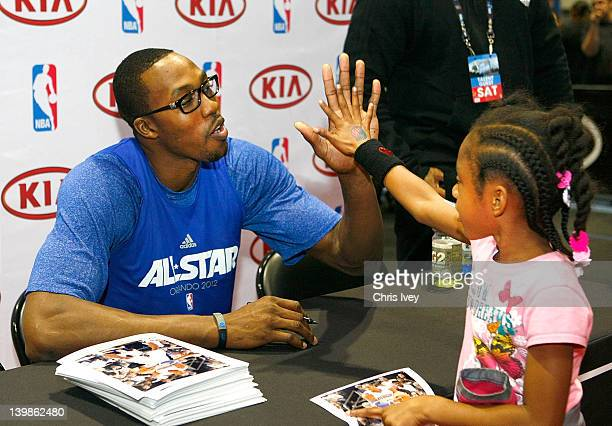 Dwight Howard Signs autographs in the Kia MVP court at Jam Session during NBA All Star Weekend on February 25 2012 at the Orange County Convention...