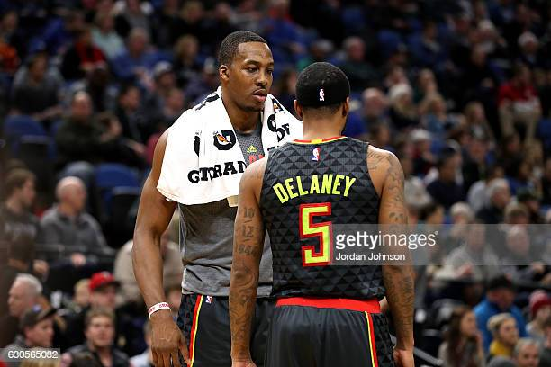 Dwight Howard talks with Malcolm Delaney of the Atlanta Hawks during the game against the Minnesota Timberwolves on December 26 2016 at Target Center...