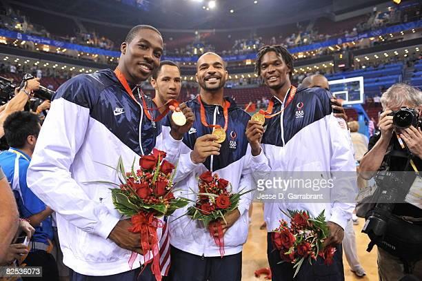 Dwight Howard Tayshaun Prince Carlos Boozer and Chris Bosh of the US Men's Senior National Team celebrates winning the men's gold medal basketball...