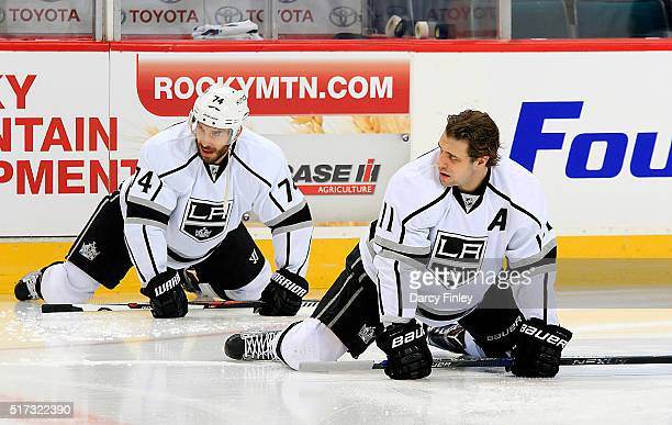 Dwight King and Anze Kopitar of the Los Angeles Kings takes part in the pregame warm up prior to NHL action against the Winnipeg Jets at the MTS...