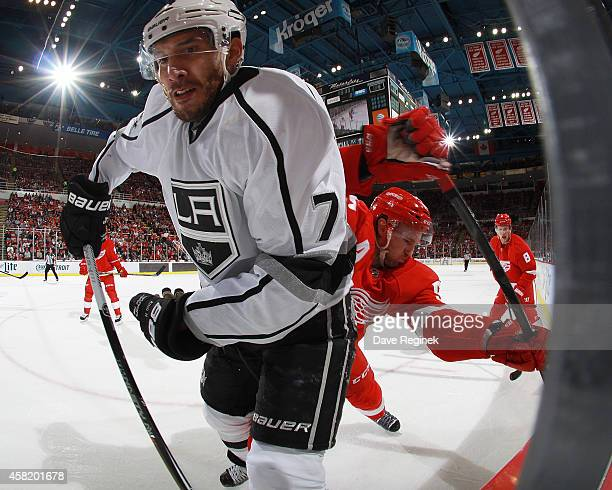 Dwight King of the Los Angeles Kings and Niklas Kronwall of the Detroit Red Wings battle in the corner in the second period during a NHL game on...