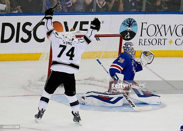 Dwight King of the Los Angeles Kings celebrates a goal by Jeff Carter of the Los Angeles Kings on Henrik Lundqvist of the New York Rangers during the...