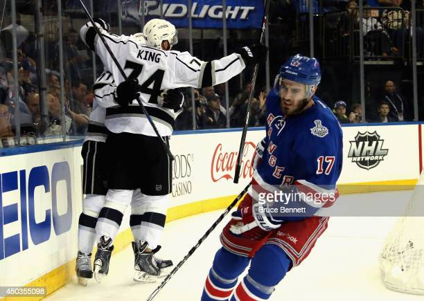 Dwight King of the Los Angeles Kings celebrates with Jeff Carter of the Los Angeles Kings after Carter's goal during the first period of Game Three...