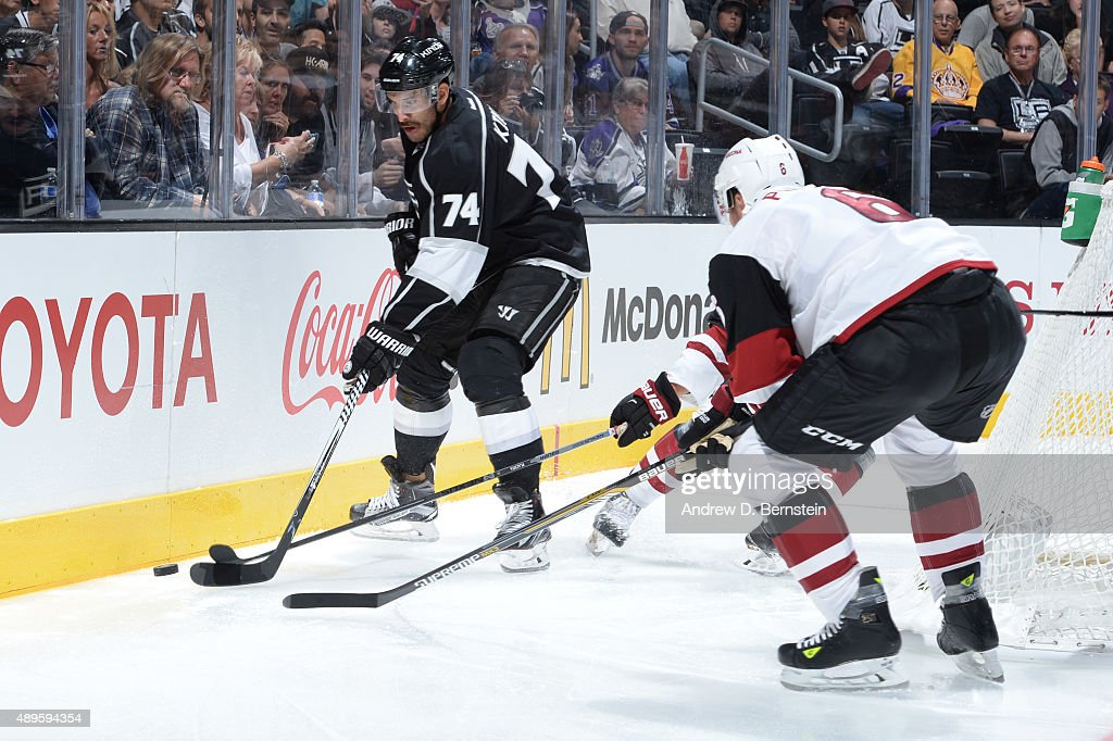 Dwight King #74 of the Los Angeles Kings handles the puck during a game against the Arizona Coyotes at STAPLES Center on September 22, 2015 in Los Angeles, California.