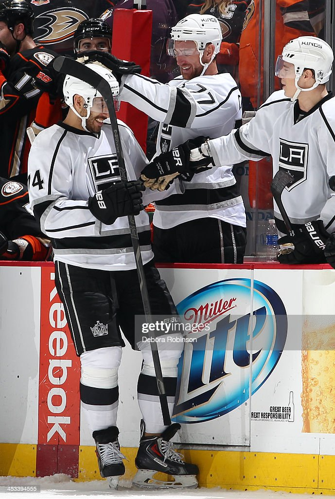 Dwight King #74 of the Los Angeles Kings is congratulated by teammates after scoring the winning goal against the Anaheim Ducks in an overtime shootout on December 3, 2013 at Honda Center in Anaheim, California. The Kings won, 3-2.