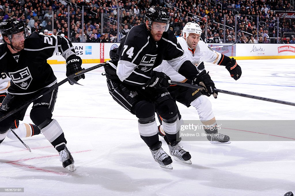 Dwight King #74 of the Los Angeles Kings reaches for the puck against the Anaheim Ducks at Staples Center on February 25, 2013 in Los Angeles, California.