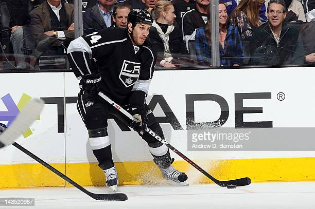 Dwight King of the Los Angeles Kings skates with the puck against the Vancouver Canucks in Game Four of the Western Conference Quarterfinals during...