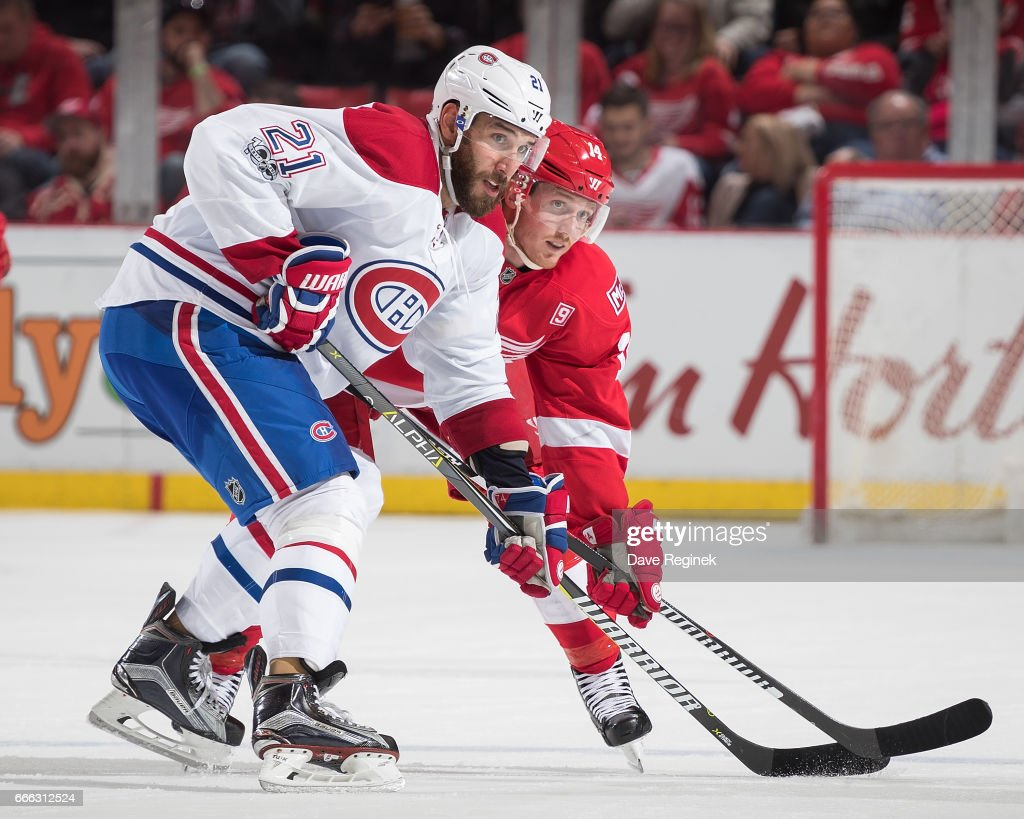 Dwight King #21 of the Montreal Canadiens battles for position with Gustav Nyquist #14 of the Detroit Red Wings during an NHL game at Joe Louis Arena on April 8, 2017 in Detroit, Michigan. The Canadiens defeated the Wings 3-2 in overtime.