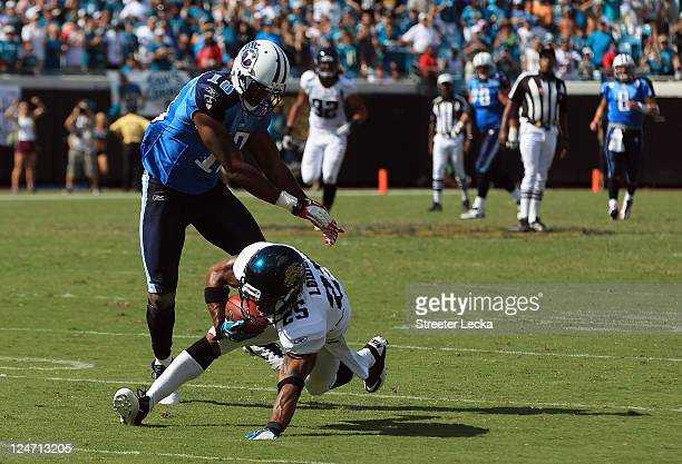 Dwight Lowery of the Jacksonville Jaguars makes an interception to seal the game with a 16-14 victory over the Tennessee Titans during their season...