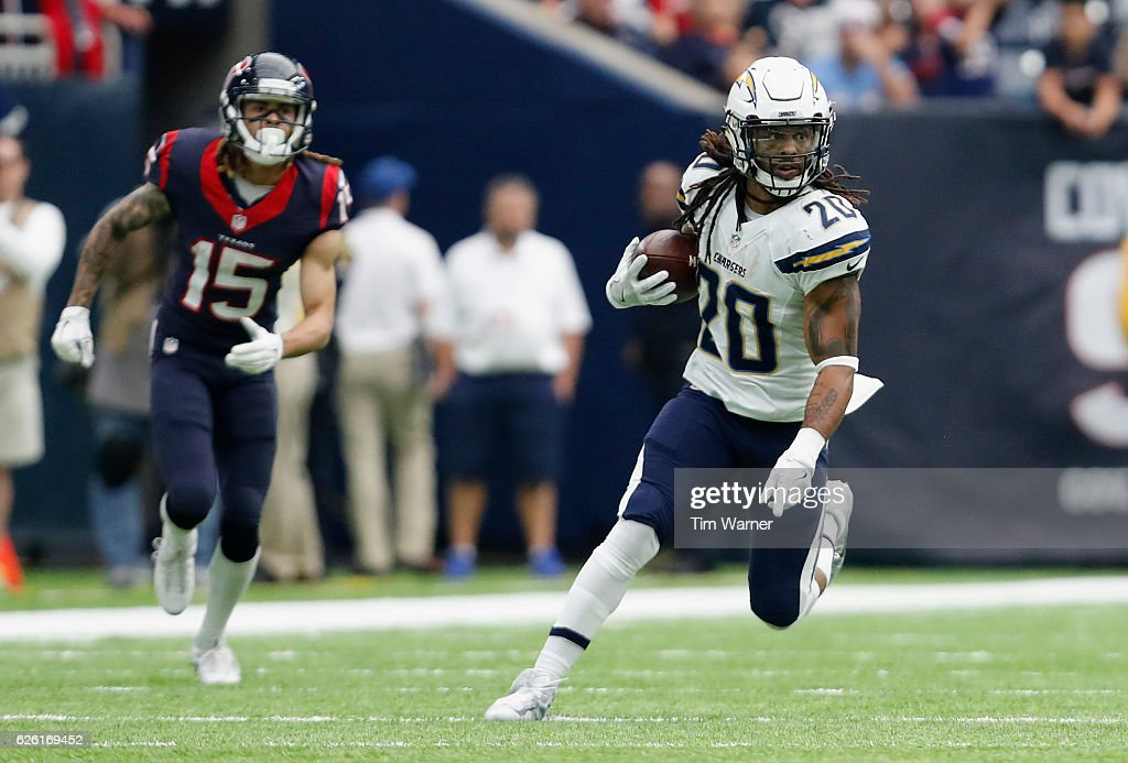 Dwight Lowery #20 of the San Diego Chargers looks for running room after an interception intended for Will Fuller #15 of the Houston Texans in the fourth quarter at NRG Stadium on November 27, 2016 in Houston, Texas.