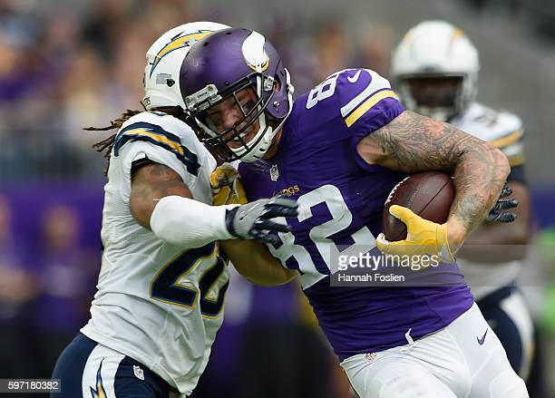 Dwight Lowery of the San Diego Chargers tackles Kyle Rudolph of the Minnesota Vikings during the second quarter of the game on August 28, 2016 at US...