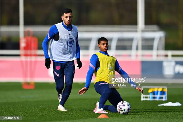 Dwight McNeil and Rhian Brewster of England challenge for the ball during the England U21 Training Session at St George's Park on March 22, 2021 in...