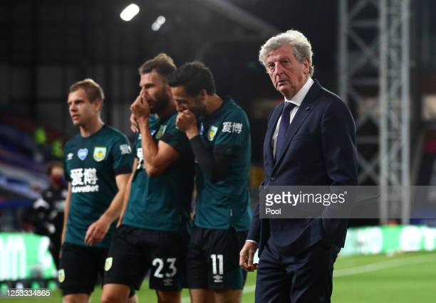 Dwight McNeil, Erik Pieters and Matej Vydra of Burnley celebrate victory together as they walk off in front of Roy Hodgson, Manager of Crystal Palace...