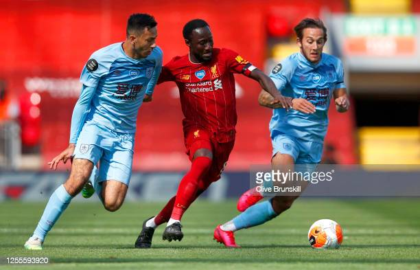 Dwight McNeil of Burnley and Naby Keita of Liverpool battle for the ball during the Premier League match between Liverpool FC and Burnley FC at...