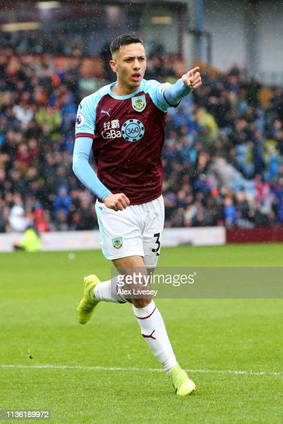 Dwight McNeil of Burnley celebrates after scoring his team's first goal during the Premier League match between Burnley FC and Leicester City at Turf...